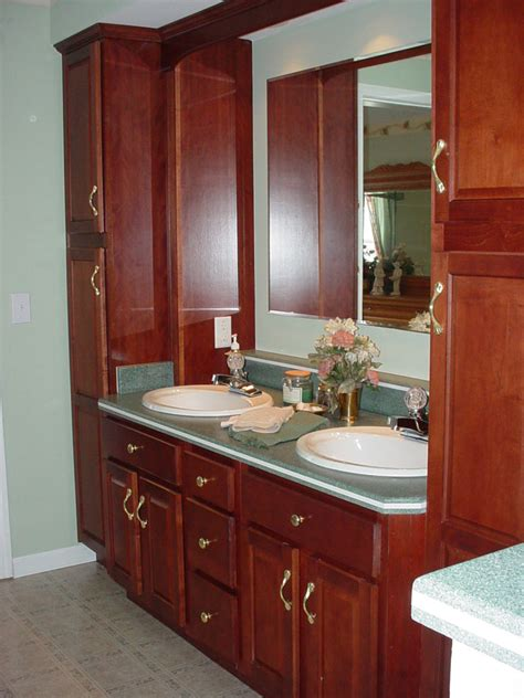 double sink vanity with linen cabinet modular home master bathroom with cherry vanities and