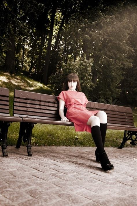 beauty woman sitting   park bench   sunlight