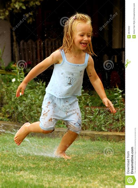 child playing  water stock photography image