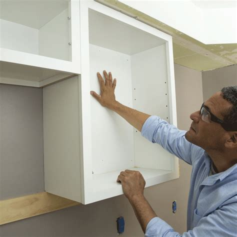 install cabinets like a pro the family handyman how to install upper kitchen cabinets install upper cabinets