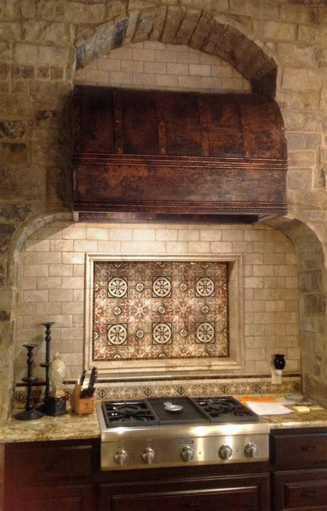 elegant kitchen backsplash created with amaretti pattern