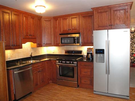 oak kitchen cabinets kitchens with black appliances red oak kitchen cabinets