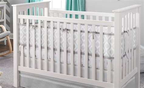 reversible crib liner gives baby one view and you another