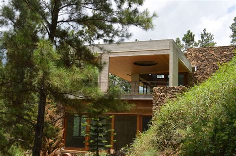 houses built on slopes grass roofed home built into slope uses hillside for