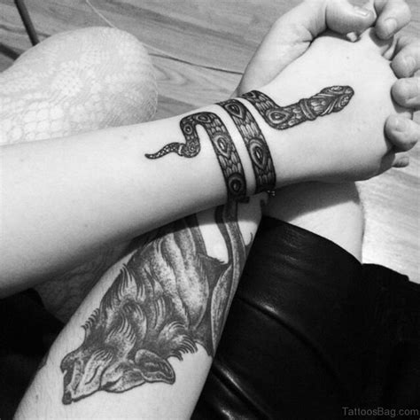 around the wrist tattoos 47 unique snake tattoos for wrist
