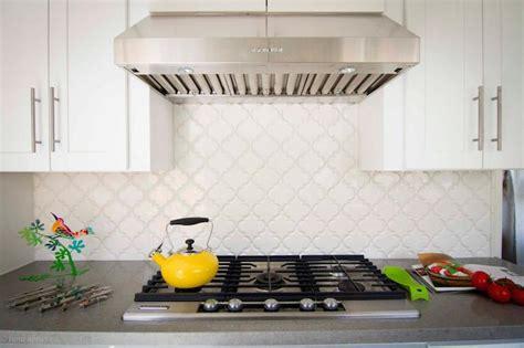 Polished Brass Sconce Arabesque Backsplash Tiles Design Ideas