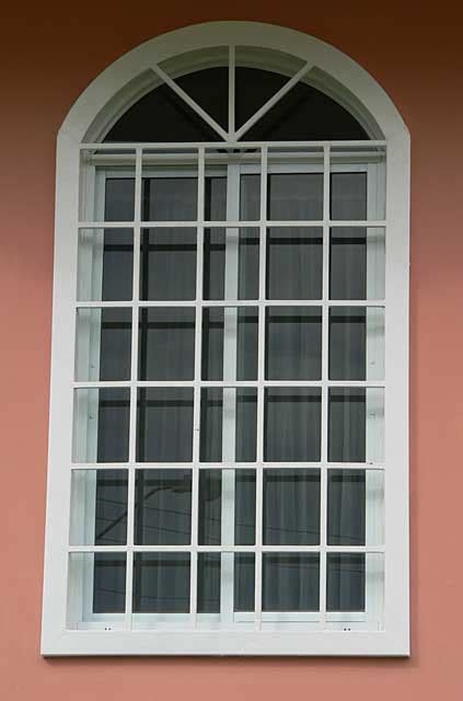 house window styles pictures photo exle of a window with security metal square frames painted in white on salmon