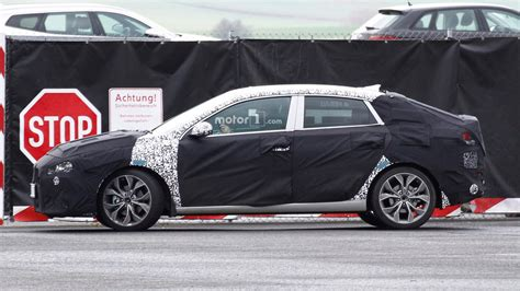 hyundai pick up still happening but not before 2020 hyundai i30 fastback spied trying to hide its stylish rear