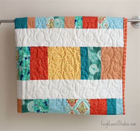 Free Patchwork Cot Quilt Patterns - bright and cheery quarter crib quilt favequilts