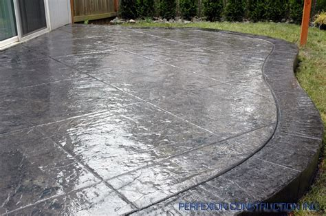 scored textured concrete patio and landscaping
