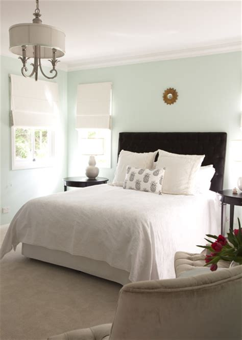 light color bedroom walls brown tufted headboard transitional bedroom porchlight interiors