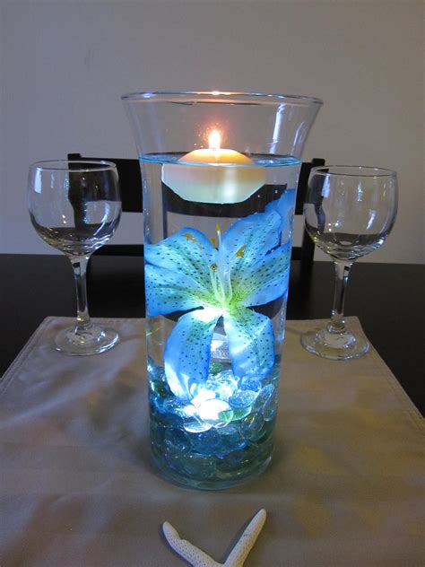 wedding centerpieces with blue submersible led lights from