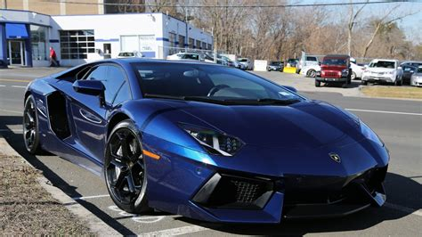 car lamborghini blue the dark blue car lamborghini aventador parked on the