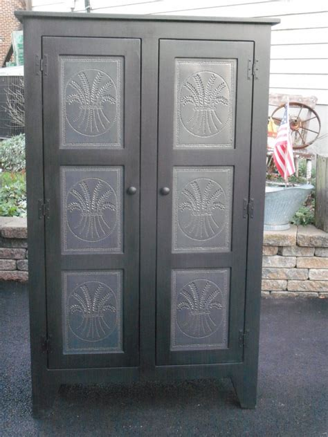 Punched Tin Cabinet Panels by Tin How To Punch Tin The Punched Tin Panels Black Iron