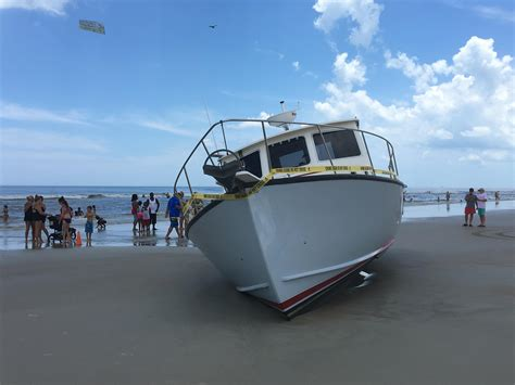 shrimp boat ashore in daytona unmanned vessel crashes ashore in daytona beach news