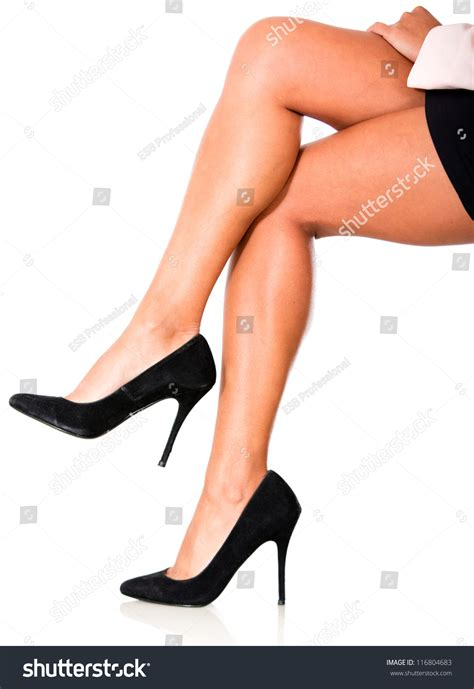 high heels and stilettos crossing legs wearing highheels isolated stock photo