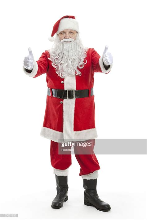 santa claus thumbs up santa claus giving a thumbs up sign stock photo getty images