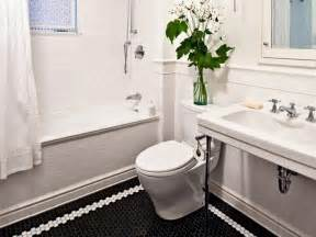 Black basket weave tile bathroom flooring and white high end bathroom