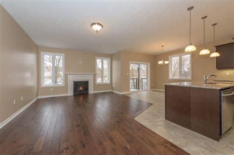 open concept flooring  wood  tile living room