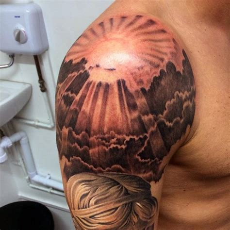 very beautiful painted colored sunrise shoulder tattoo
