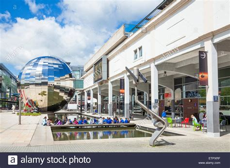 at bristol science centre school children outside planetarium sphere and science