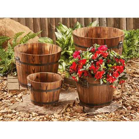 Decorative Wooden Planters by Castlecreek Wooden Barrel Planter Set 4 657794