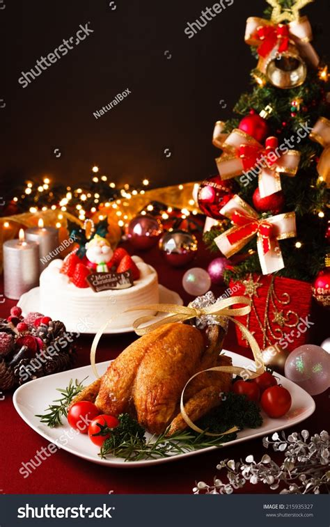 christmas themed dinner table stock photo 215935327