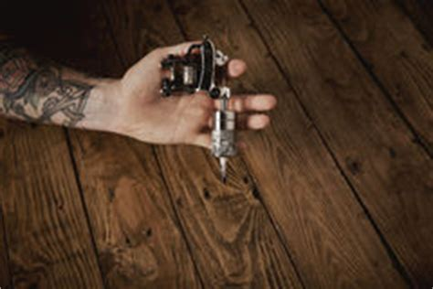 tattoo gun up close scar on man hand stock images image 35807084