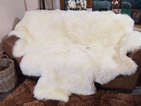 Sheepskin Rug On Sofa by Flooring Cozy White Sheepskin Rug On Wood Tile Flooring