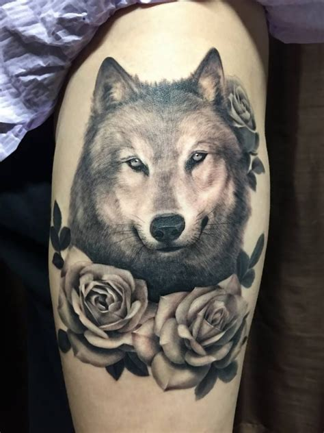 wolf with rose tattoo wolf with roses wolf tats tats animal tats