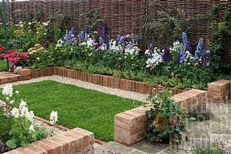 Small Garden Border Ideas Gardening With Bricks Small Garden With Brick Border Border Delphinium Lavatera