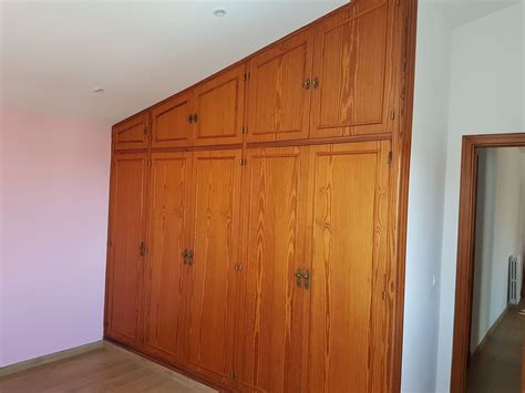 armario empotrado leroy merlin cambiar puertas abatibles a correderas en armario