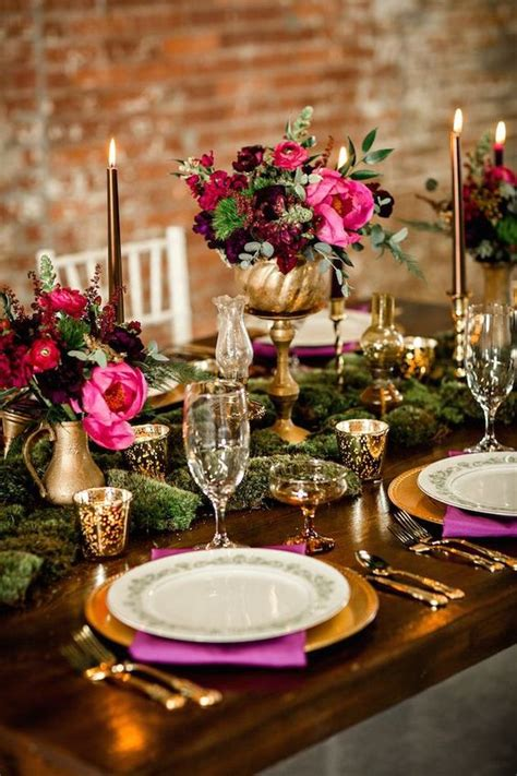 Picture Of burgundy and hot pink centerpieces in gold