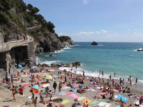 best italian beaches there s a price to pay for saving spots at italian beaches