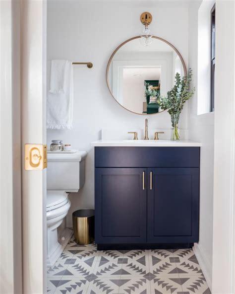 modern guest bathroom  gold accents  geometric