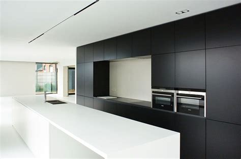 corian zwart kachet architects keuken kitchen zwart wit corian