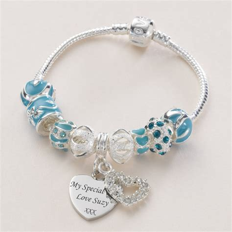 charm bead bracelet with engraved charm in turquoise