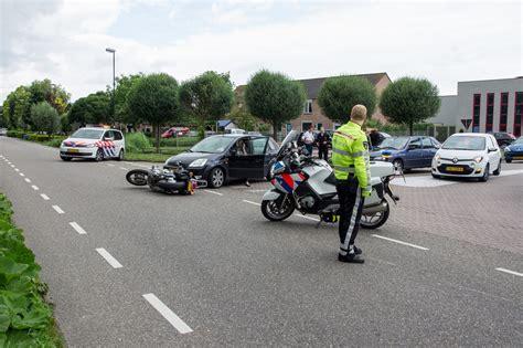 arkel motors blikschade bij aanrijding auto en motor op de vlietskade