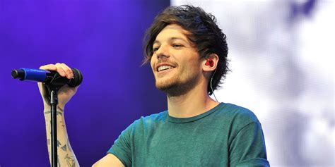 louis tomlinson label one direction s louis tomlinson signs solo record deal