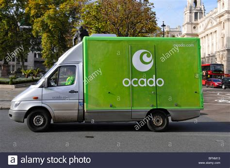 ocado groceries delivery van driver and mate in