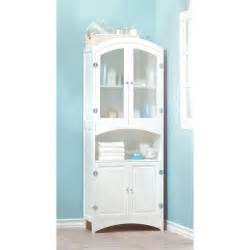 bathroom features tall white linen cabinet