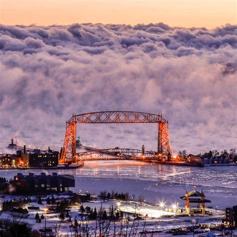 duluth sea smoke wall of sea smoke towers behind the aerial lift bridge in