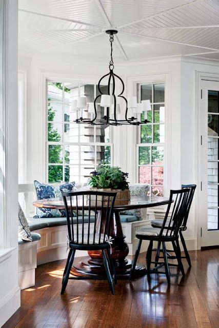 built  bay window seat   table  black chairs
