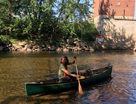 swift river boat launch woman paddling androscoggin river to highlight water