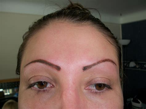 tattooed on eyebrows want thicker eyebrows try eyebrow implants
