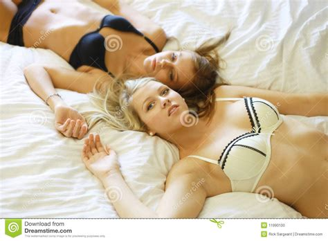 hot girls in bed together bed time stock photo image 11990100