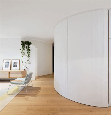curved walls a curved wall in this apartment hides a fully stocked bar contemporist