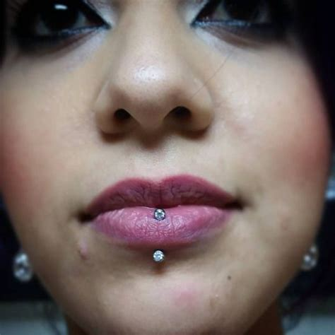 adornment tattoo 1000 images about lip piercings on labret