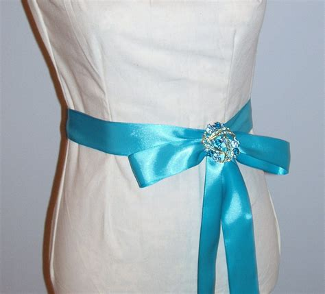 turquoise wedding gown sash with turquoise brooch