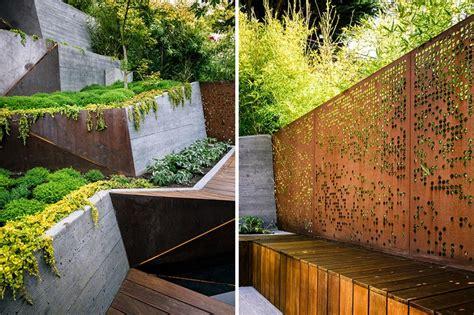 landscape backyard multi layered japanese style garden and sitting area